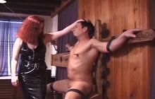 Redhead dominatrix punishes her man