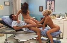 Hot nurses servicing a patient