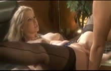 Two Busty Babes Fucking In The Office With A Huge Strapon