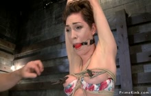 Tied and tapped babe is toyed