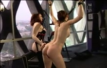 Dominant chick playing with a lesbian slave